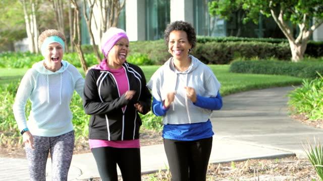 multi-ethnic senior women enjoying exercising together - racewalking stock videos and b-roll footage