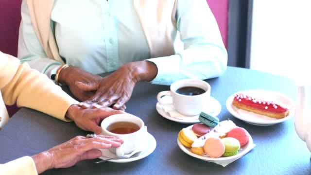 multi-ethnic senior women having coffee, admiring ring - only senior women stock videos & royalty-free footage