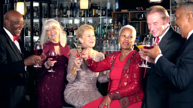 multi-ethnic seniors at bar, toasting - evening gown stock videos & royalty-free footage
