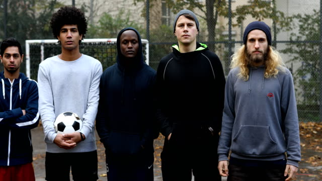 multi-ethnic soccer team standing with ball - soccer player stock videos & royalty-free footage
