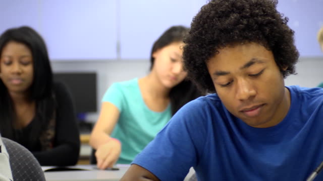 multi-ethnic students in classroom - front focus - secondary school stock videos and b-roll footage