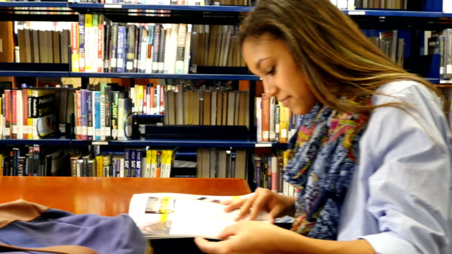 Multi-ethnic students studying at local or school library
