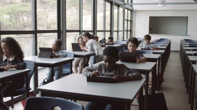 multi-ethnic students using digital tablets - schoolboy stock videos & royalty-free footage