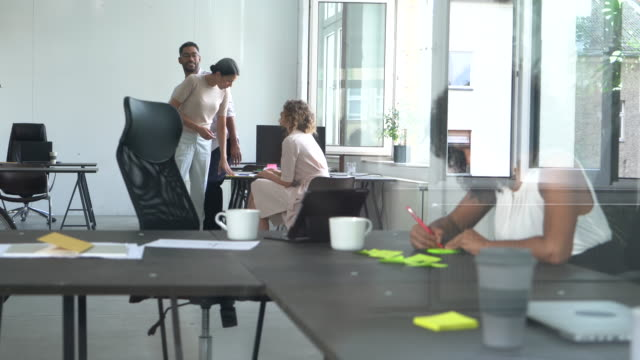 multiethnic team at work - coworking stock videos & royalty-free footage