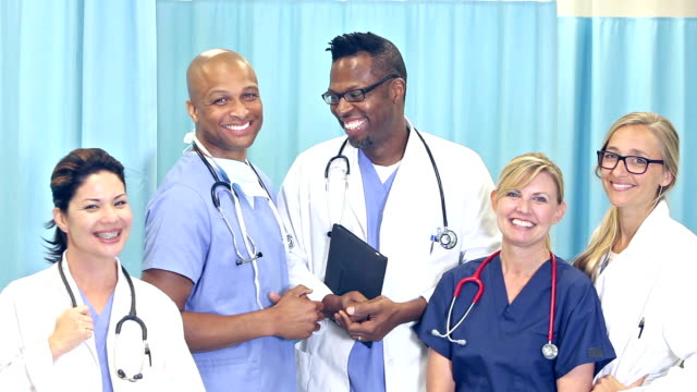multi-ethnic team of doctors and nurses - medical student stock videos and b-roll footage
