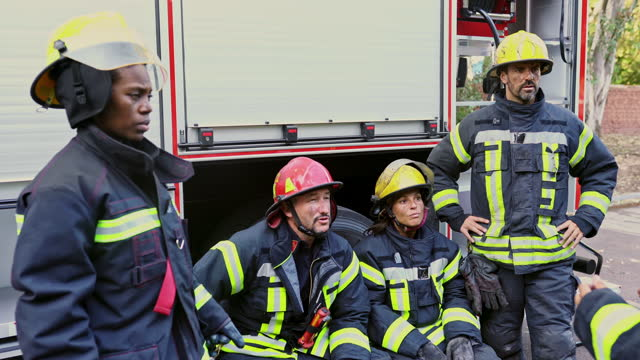 multi-ethnic team of first responders talking on location - resting stock videos & royalty-free footage