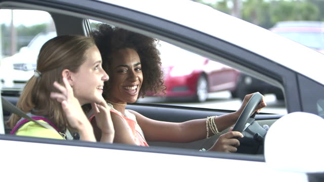 multi-ethnic teenage girls in a car talking and laughing - teenagers only stock videos & royalty-free footage