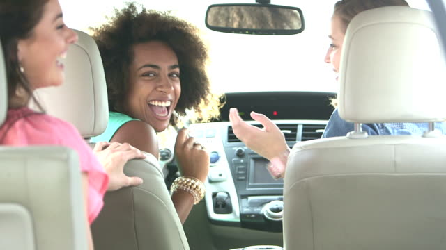 multi-ethnic teenage girls in car, laughing, singing - teenagers only stock videos & royalty-free footage