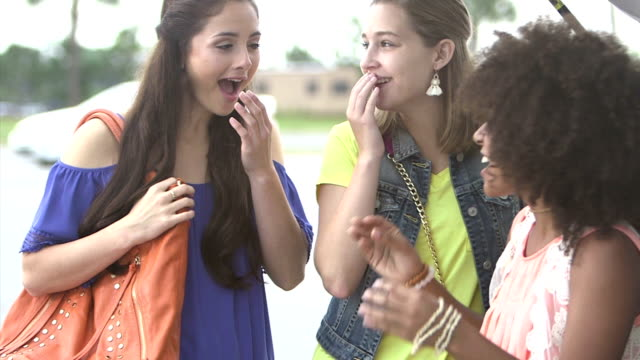 multi-ethnic teenage girls laughing in parking lot - three people stock videos & royalty-free footage