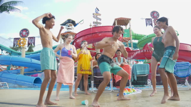 multi-ethnic teenagers dancing at water park - showing off stock videos & royalty-free footage