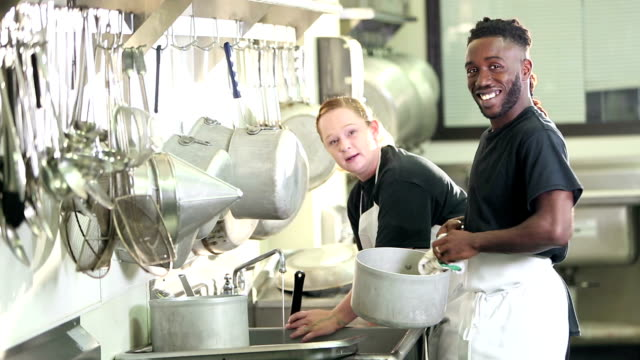 multi-ethnic workers in commercial kitchen washing pots - caterer stock videos and b-roll footage