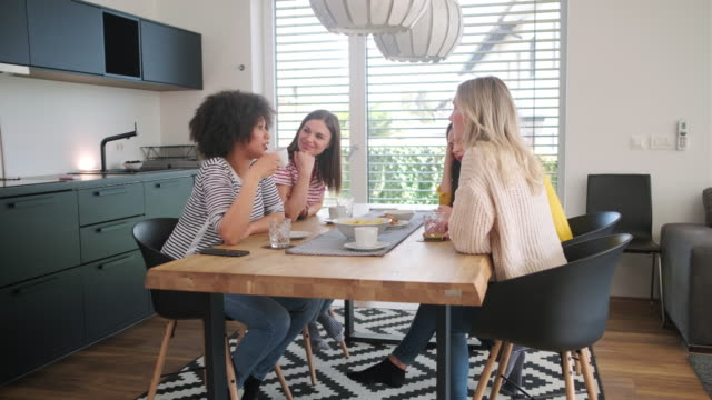 multi-ethnic young women talking at dining table - dining table stock videos & royalty-free footage