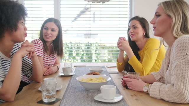 multi-ethnic young women talking at dining table - four people stock videos & royalty-free footage