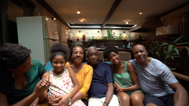 multi-generation african hispanic family at home portrait - unity stock videos & royalty-free footage