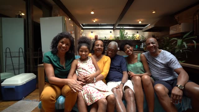 multi-generation african hispanic family at home portrait - organised group photo stock videos & royalty-free footage