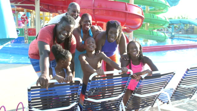 Multi-generation African-American family at water park