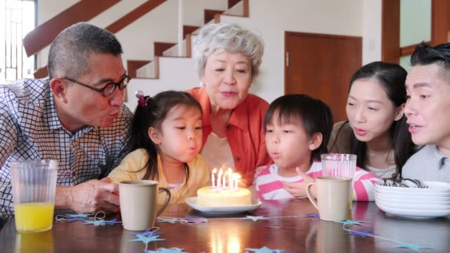 multi-generation chinese family celebrating child's birthday at home - life events stock videos & royalty-free footage