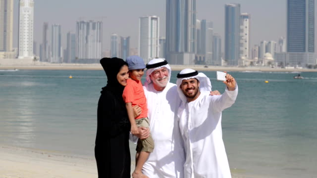 multi-generation emirati family taking a selfie - middle eastern ethnicity stock videos & royalty-free footage