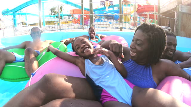 Multi-generation family at water park on lazy river
