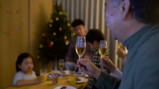Multi-generation family eating Christmas day together