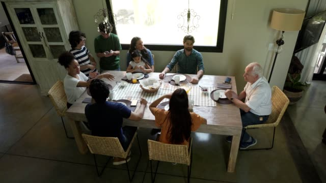 multi-generation family enjoy breakfast together - family reunion stock videos and b-roll footage