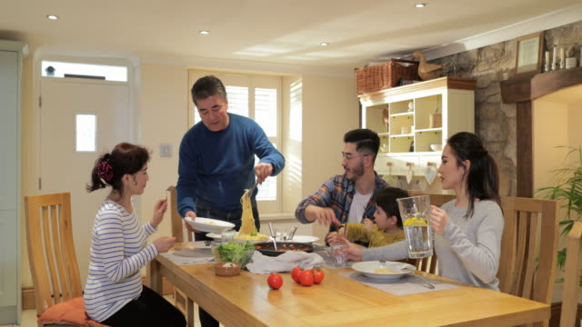 multi-generation family feast - dining room stock videos & royalty-free footage