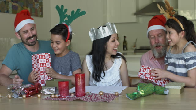 multi-generation family giving christmas presents to each other - christmas gift stock videos & royalty-free footage