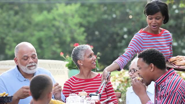 Multi-generation family having a BBQ