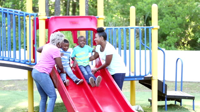 Multi-generation family on playground with two boys