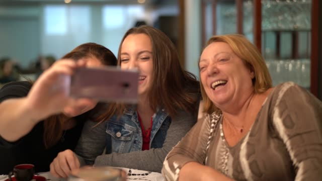 multi-generation family taking a selfie - grandchild stock videos & royalty-free footage