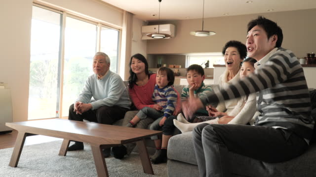 multi-generation family watching tv in the living room - japan stock videos & royalty-free footage