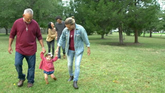 multi-generation hispanic family, walking baby - adulation stock videos & royalty-free footage
