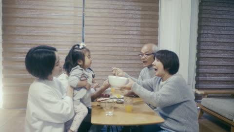 multi-generation japanese family eating toshikoshi soba (new year's eve noodles) noodles - japanese food stock videos & royalty-free footage