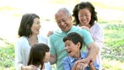 Multi-generation Japanese family outdoors