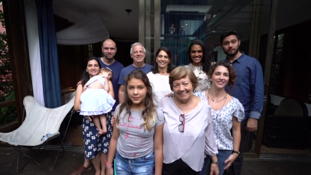 multi-generation latin family at home portrait - large family stock videos & royalty-free footage