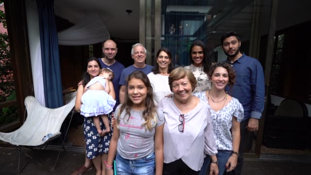 multi-generation latin family at home portrait - family portrait stock videos & royalty-free footage