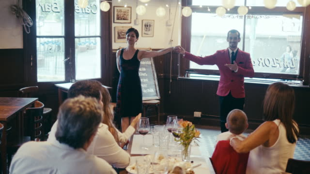 multi-generation latin-american family applauding to the tango show in the restaurant - tangoing stock videos & royalty-free footage