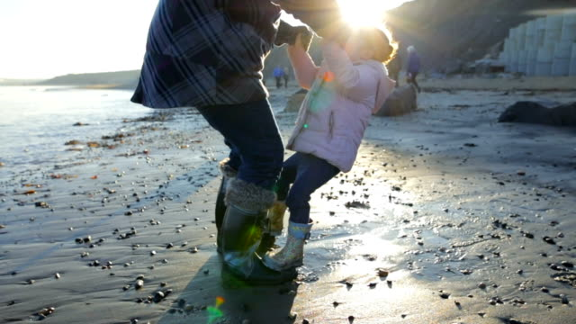 multi-generation playing on the beach! - retirement stock videos & royalty-free footage