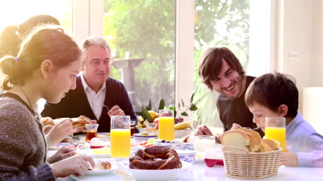 multi-generation turkish family having breakfast - multi generation family stock videos & royalty-free footage