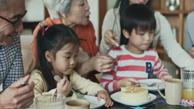 multi-generational chinese family eating birthday cake - grandchild stock videos & royalty-free footage