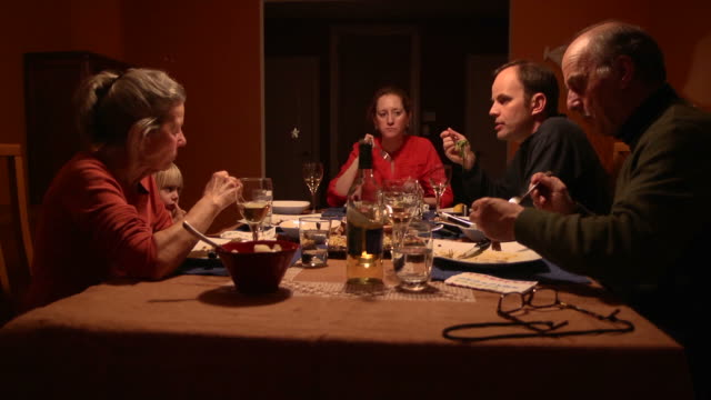 multi-generational dinner - multi clip - evening meal stock videos & royalty-free footage