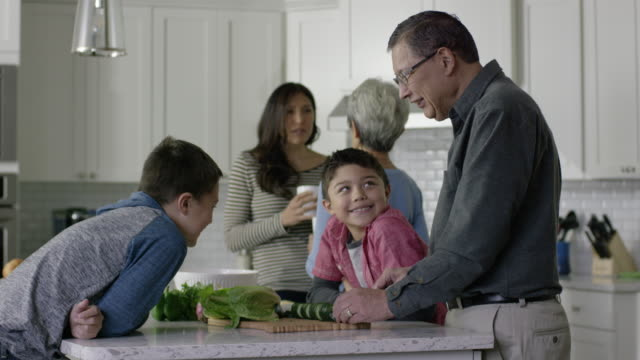 Multi-Generational Ethnic Family Hanging Out in the Kitchen