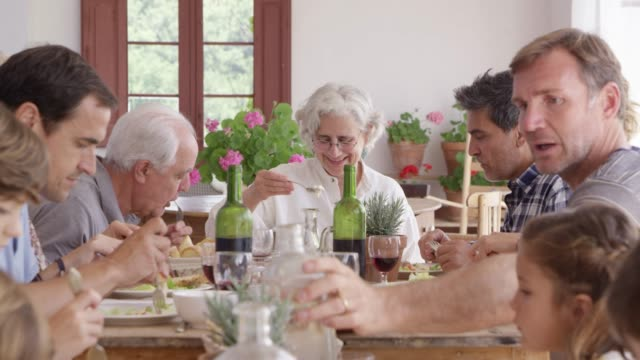 multi-generational family enjoying food at home - multi generation family stock videos & royalty-free footage