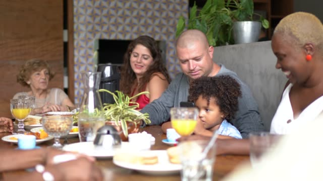 multigenerational family having breakfast together - large family stock videos & royalty-free footage