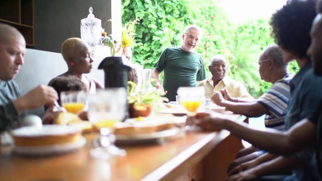 multigenerational family having breakfast together - bonding stock videos & royalty-free footage