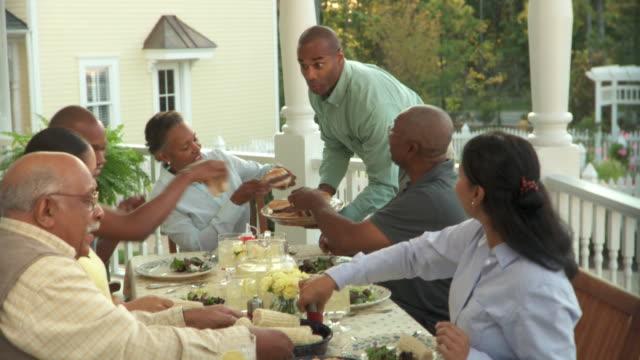 MS, Multigenerational family having dinner on porch, Richmond, Virginia, USA