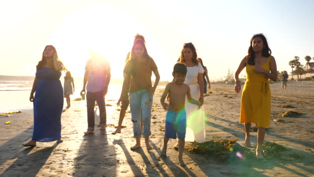 ms multigenerational family walking together on beach at sunset - pacific islander family stock videos & royalty-free footage
