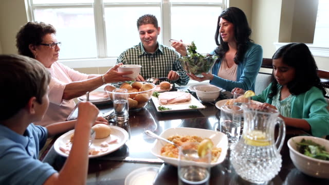 multi-generational hispanic family enjoying dinner and quality time together - breakfast table stock videos and b-roll footage