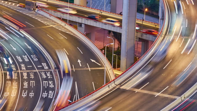 4k: multilevel viaduct traffic at sunset to night time lapse, shanghai, china - sunset to night time lapse stock videos & royalty-free footage