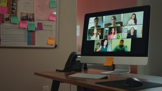 multi-person virtual call on a screen in an office - 50 59 years stock videos & royalty-free footage